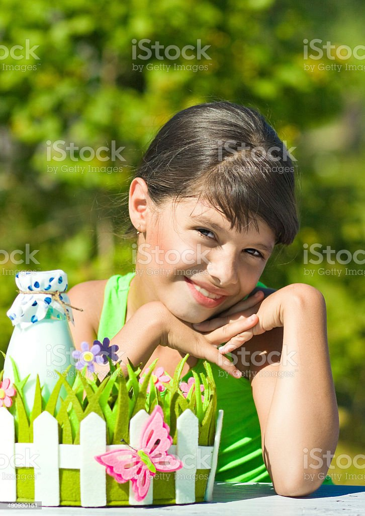 Smiling girl with bottle of milk royalty-free stock photo