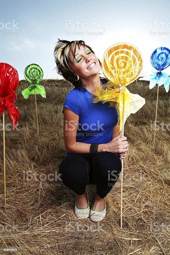 Smiling Girl with Bright Makeup and Lollipops royalty-free stock photo