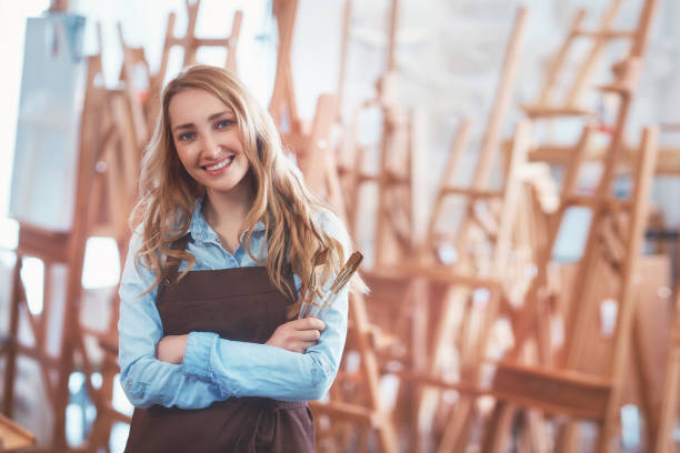 Smiling girl with brushes stock photo