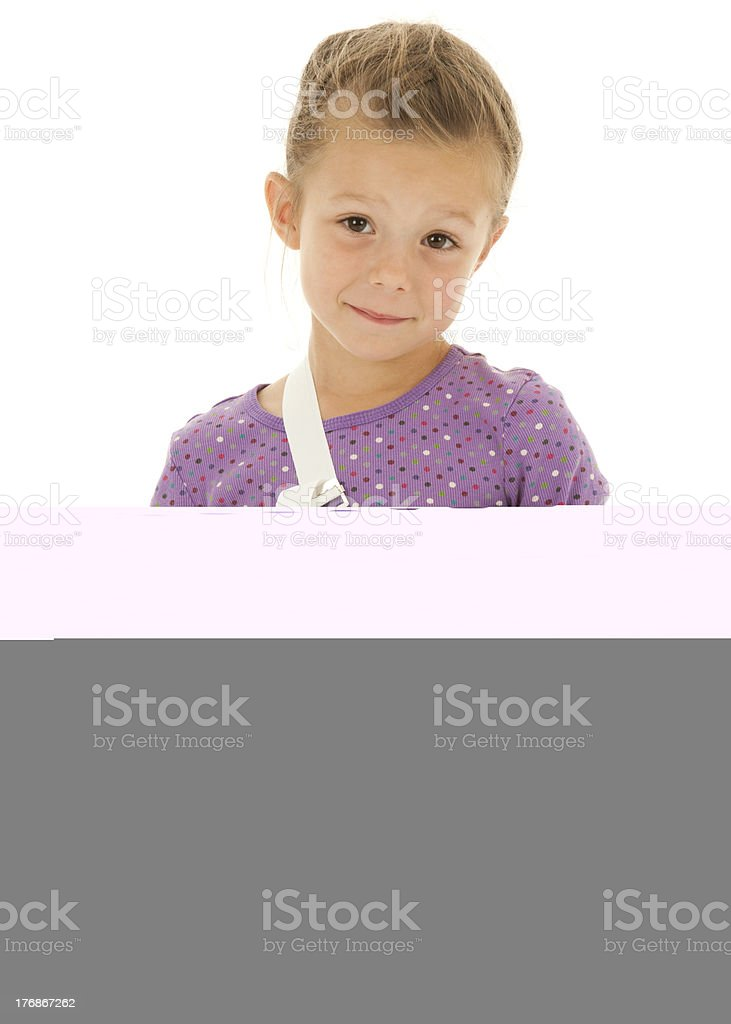 Smiling Girl with Cast on Broken Arm Having Fun stock photo