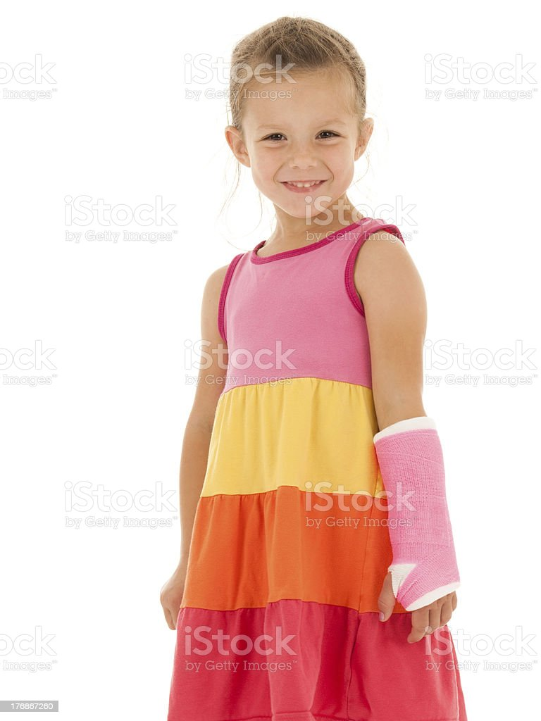 Smiling Girl with Cast on Broken Arm stock photo