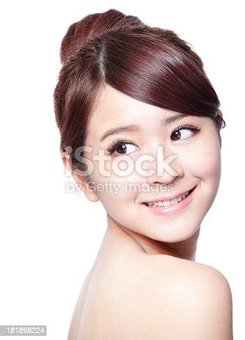 525211834istockphoto Smiling girl with clean skin looking back over her shoulder 181868224
