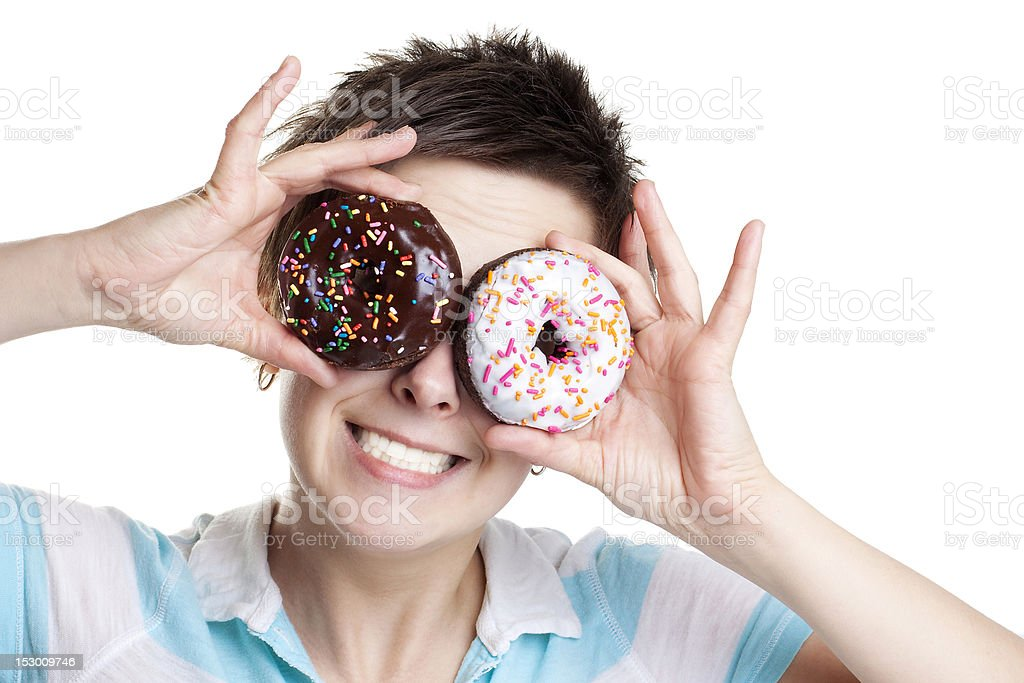 Smiling girl with donuts as eyes royalty-free stock photo