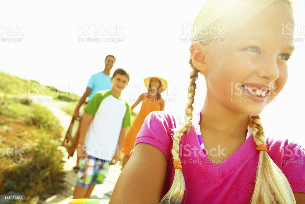 Smiling girl with family royalty-free stock photo