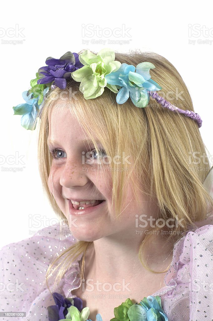 Smiling girl with flower headband and a flower dress. royalty-free stock photo