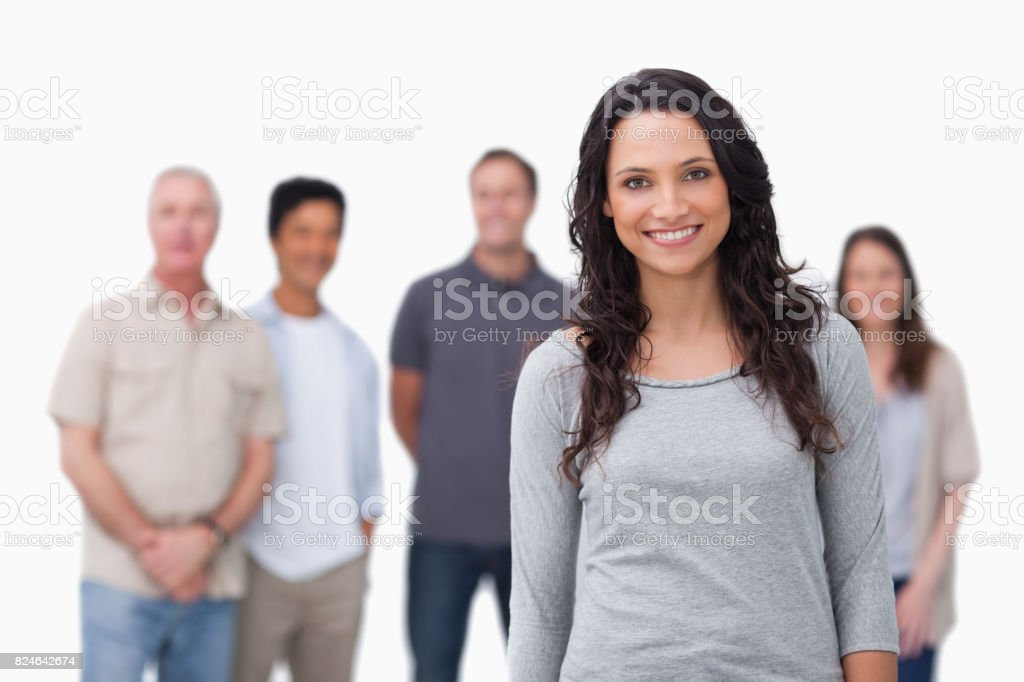 Smiling girl with friends standing behind her stock photo