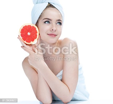 532331272 istock photo Smiling girl with grapefruit, natural organic raw fresh food concept 512805822