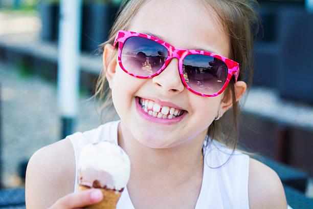01a8f1721568 Top 60 Girl Eating Ice Cream Cone Stock Photos