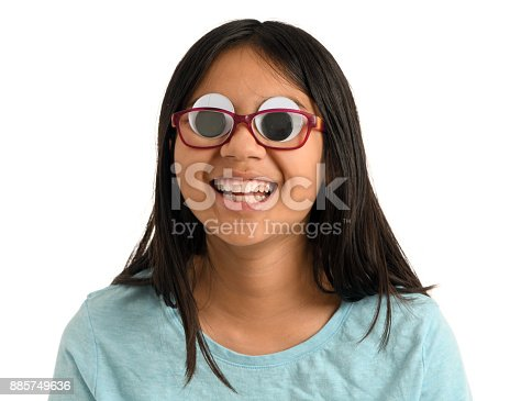 A girl wearing glasses with large googly eyes and a big toothy smile. White background.