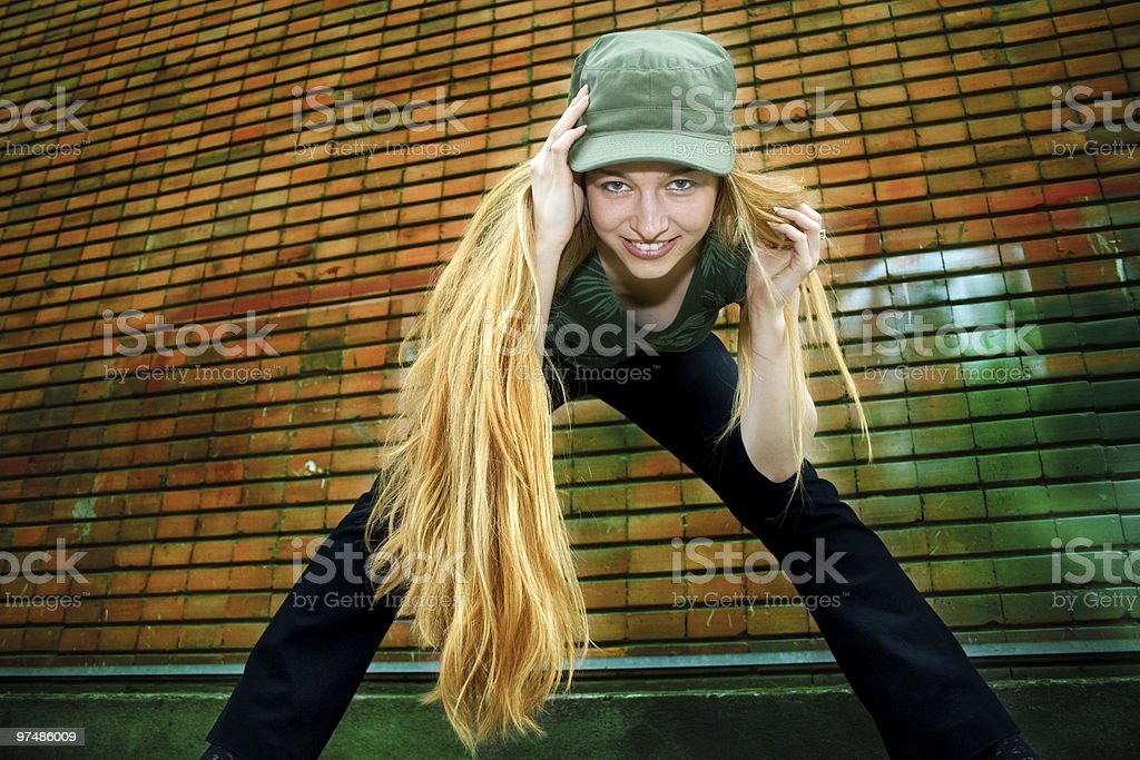Smiling girl with long blond hair royalty-free stock photo