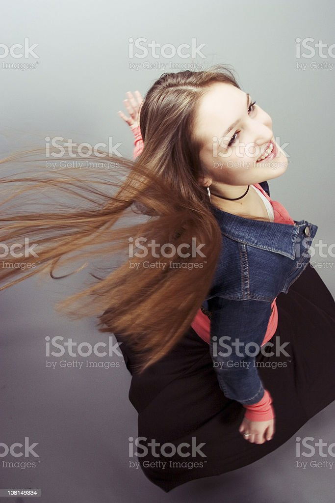 Smiling Girl with Long Hair and Skirt Blowing in Wind royalty-free stock photo