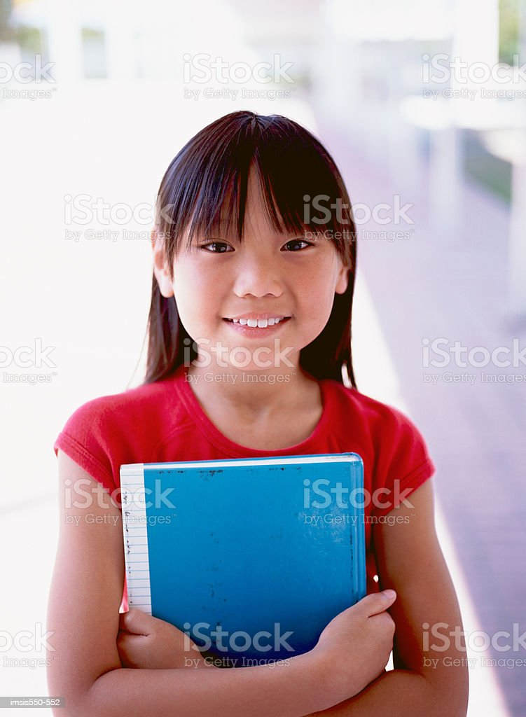 Smiling girl with notebook royalty-free stock photo