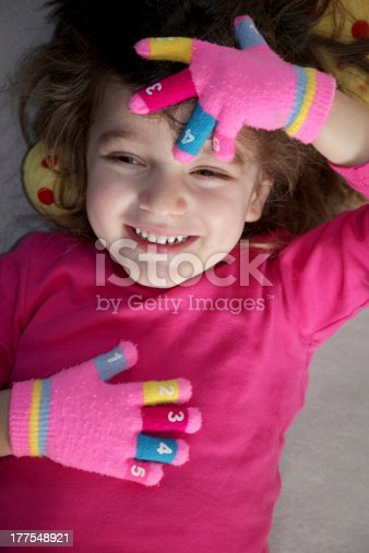 693519466 istock photo Smiling girl with numbers on her gloves 177548921