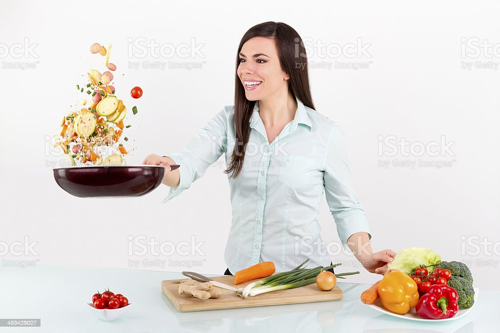 Smiling girl with pan stock photo
