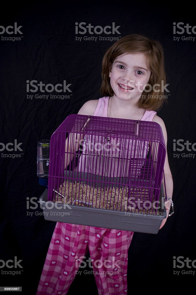 Smiling girl with pet cage royalty-free stock photo