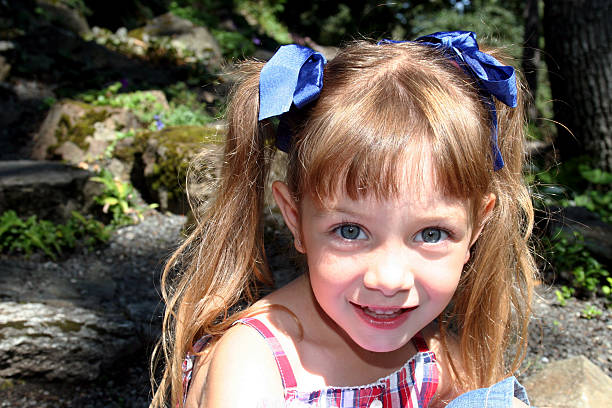 Smiling girl with pigtails stock photo