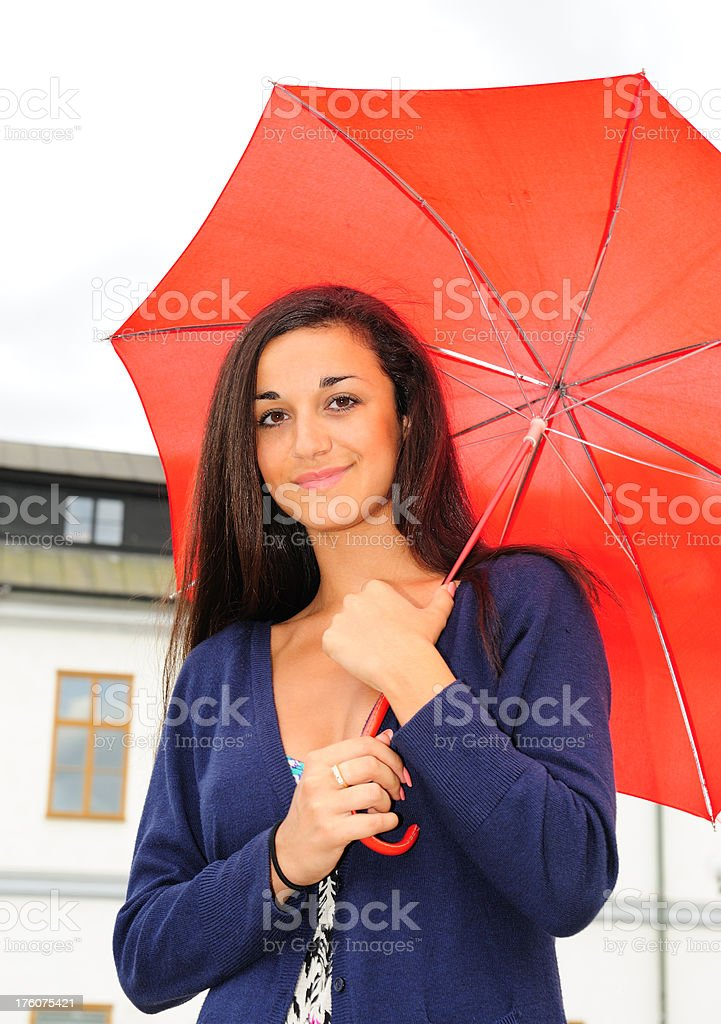 Smiling girl with red umbrella royalty-free stock photo