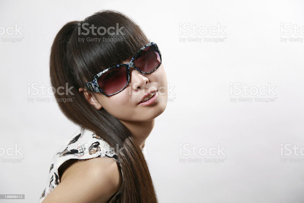 Smiling girl with sunglasses royaltyfri bildbanksbilder