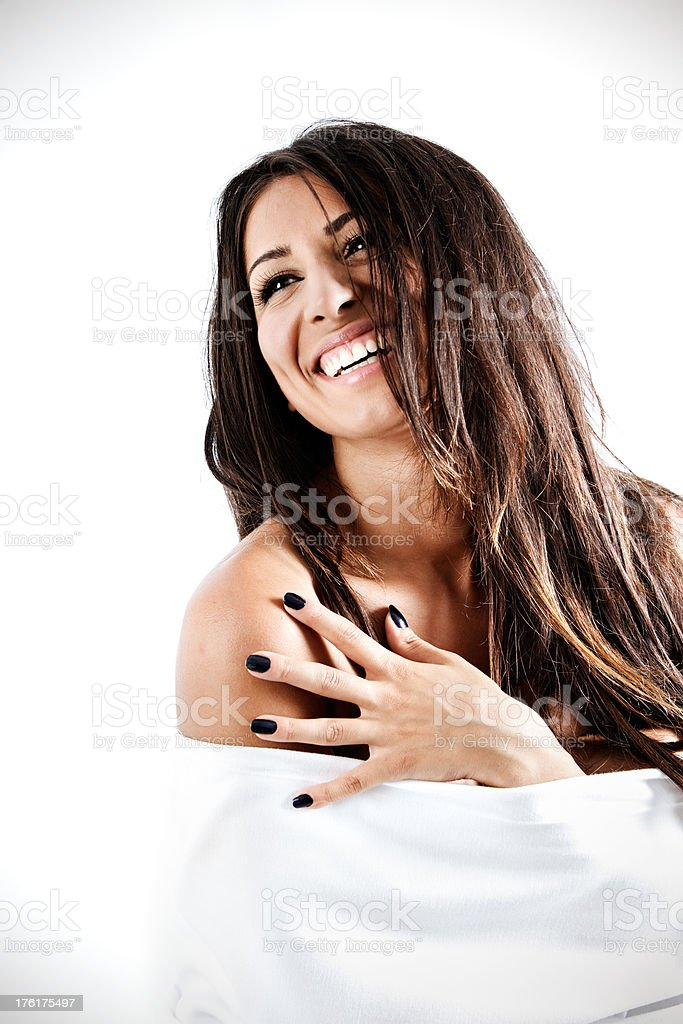 Smiling girl wrapped in sheets royalty-free stock photo