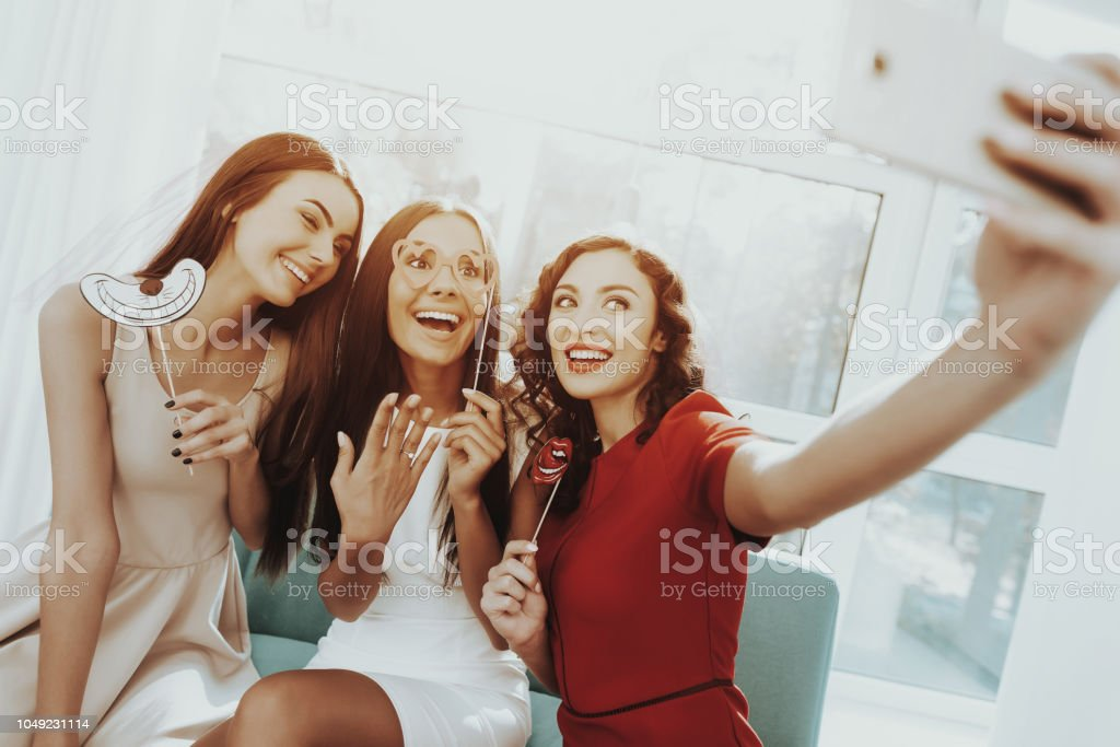 Smiling Girls Are Doing Selfie On A Hen-party. stock photo