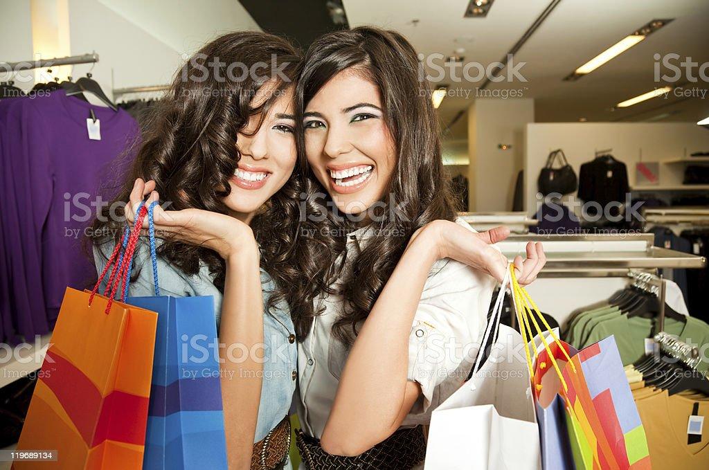 smiling girls shopping royalty-free stock photo