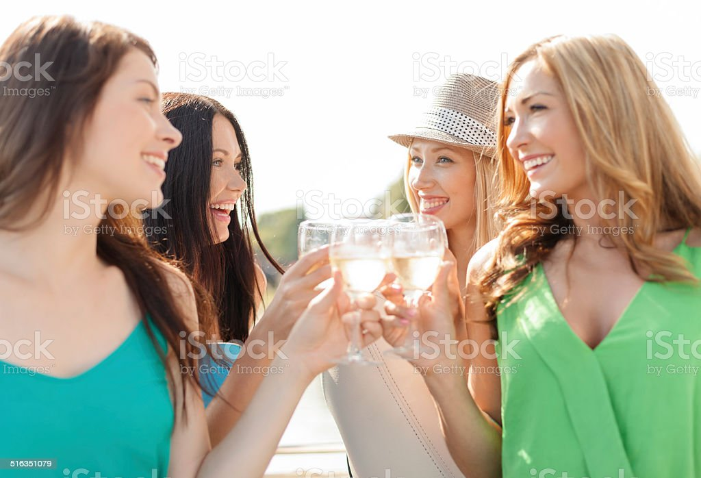 smiling girls with champagne glasses stock photo