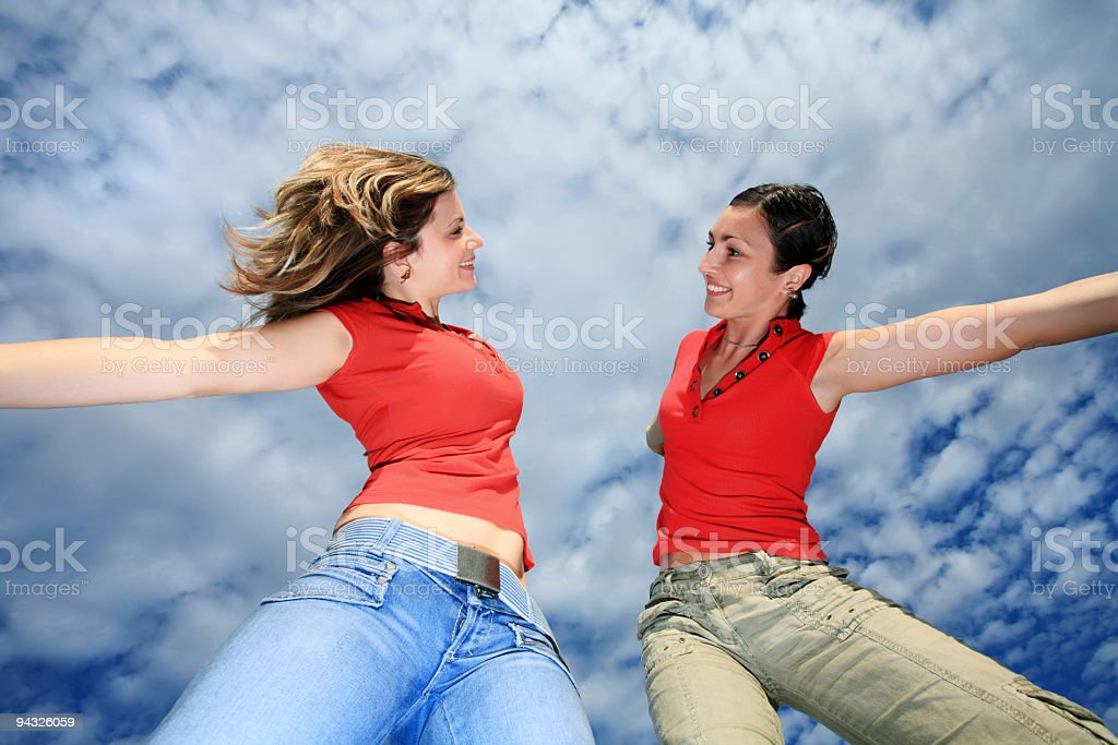 Smiling girls with open hands. royalty-free stock photo