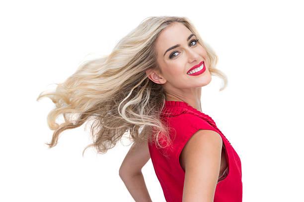 lächelnd blonde posieren glamourösen - wickelkleid lang stock-fotos und bilder