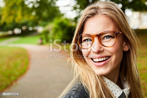 Portrait of beautiful smiling girl in glasses