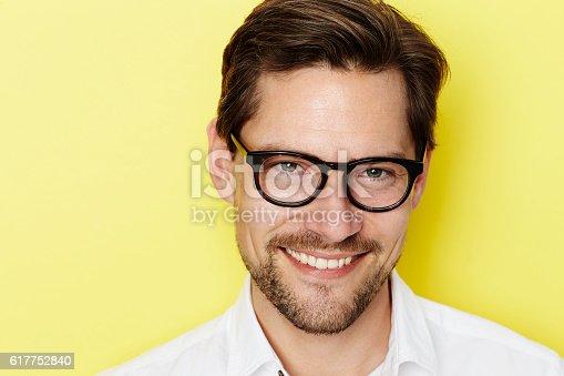 649754038 istock photo Smiling glasses guy 617752840