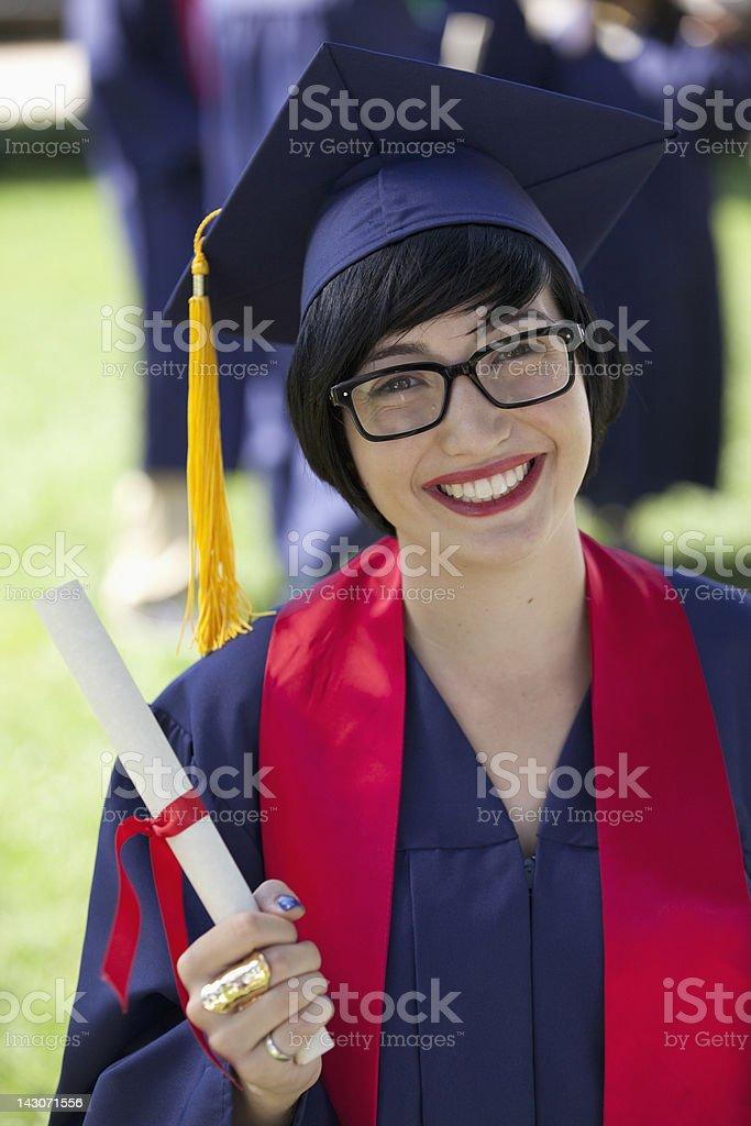 Smiling graduate holding diploma royalty-free stock photo
