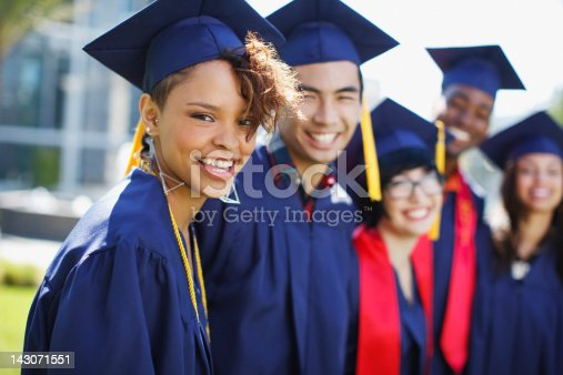 istock Smiling graduates standing together outdoors 143071551