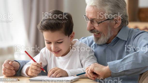 Smiling grandfather playing drawing colored pencils with little picture id1170534197?b=1&k=6&m=1170534197&s=612x612&h=slrl dohf78m8usbf1il9rlnplvxdilvuxdwihtye6q=