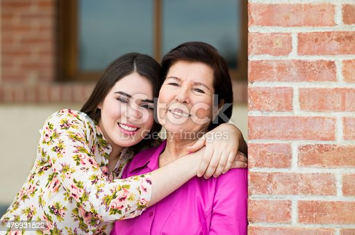 144362548istockphoto Smiling grandmother and granddaughter 479931522