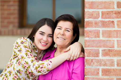 144362548 istock photo Smiling grandmother and granddaughter 479931522