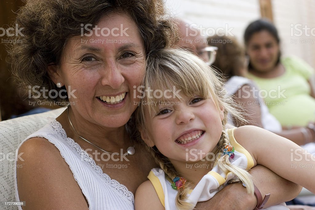 Smiling Grandmother & Granddaughter at Party stock photo