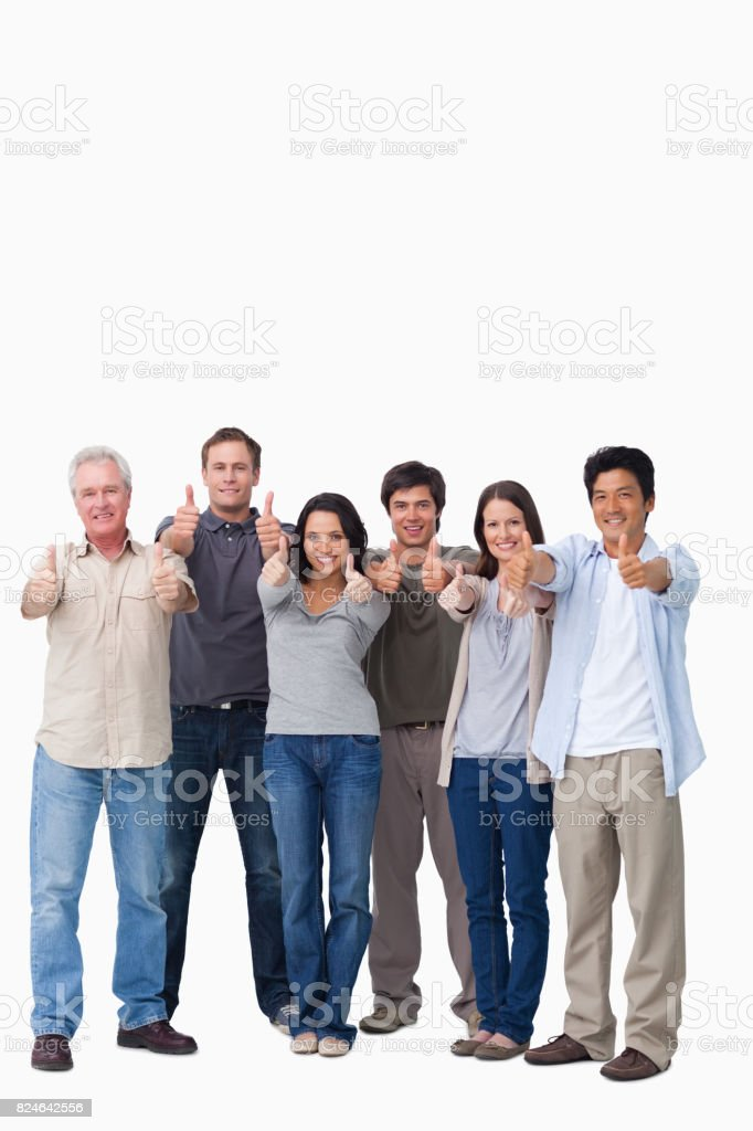 Smiling group giving thumbs up stock photo