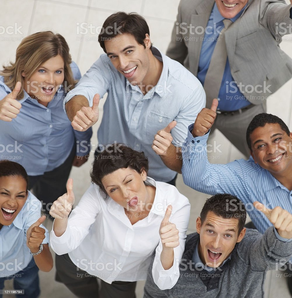 Smiling group of business people showing you a success sign royalty-free stock photo