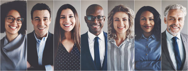 smiling group of ethnically diverse businessmen and businesswomen - people stock pictures, royalty-free photos & images