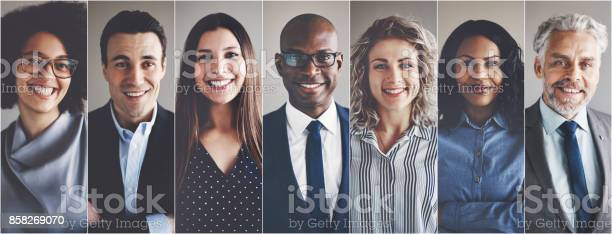 Smiling Group Of Ethnically Diverse Businessmen And Businesswomen Stock Photo - Download Image Now