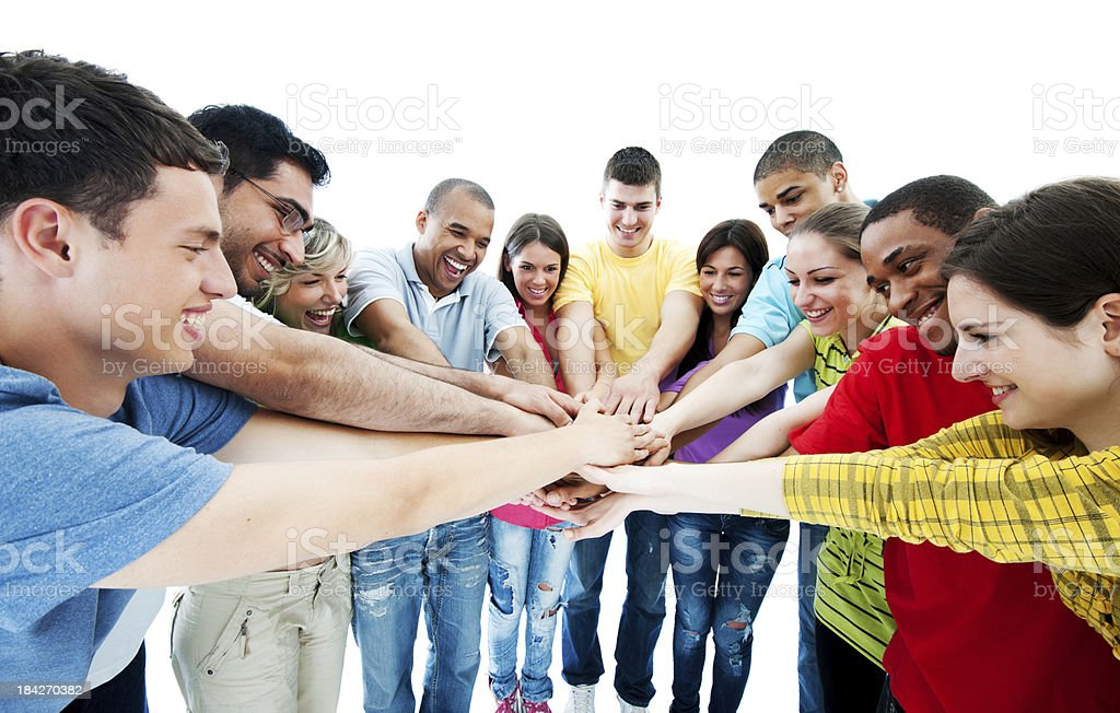 Smiling group standing in a circle royalty-free stock photo