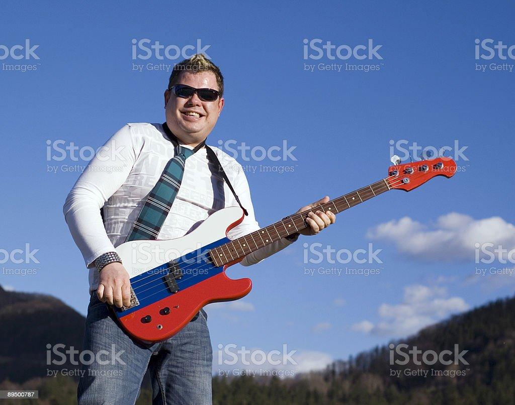 Sorridente guitar player foto stock royalty-free