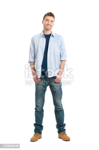 Happy smiling young man standing full length isolated on white background.