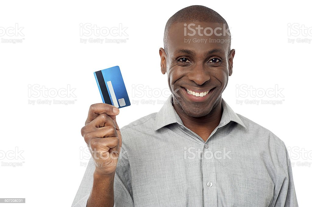 Smiling guy holding credit card stock photo