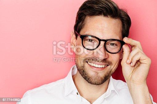 649754038 istock photo Smiling guy in glasses 617744960