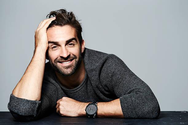 Smiling guy in grey stock photo