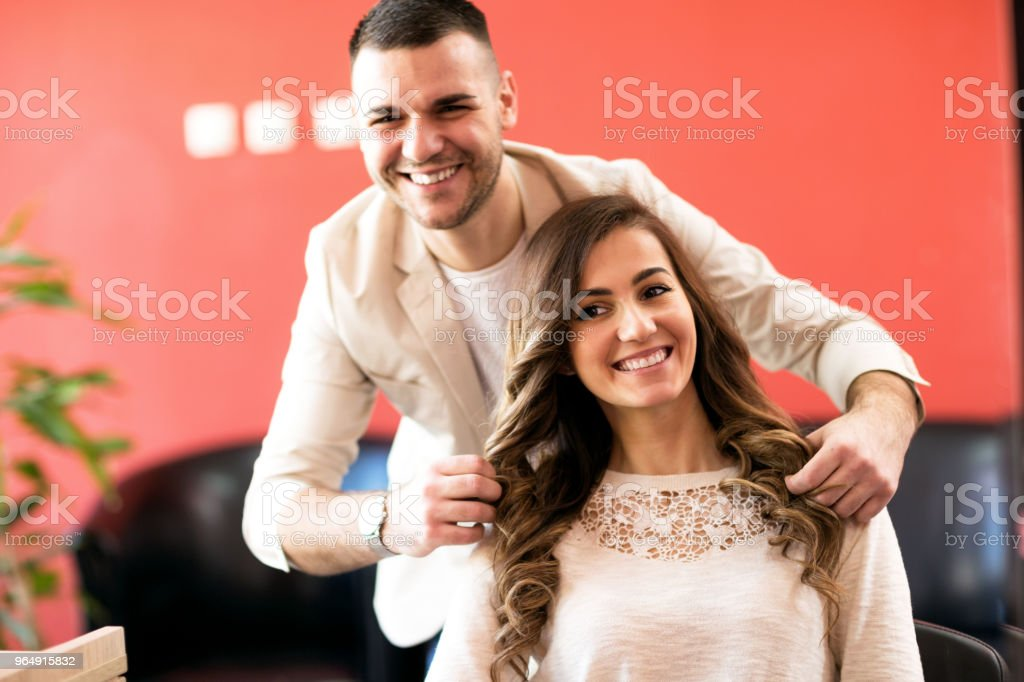 Smiling hairsyilist and his satisfied client royalty-free stock photo