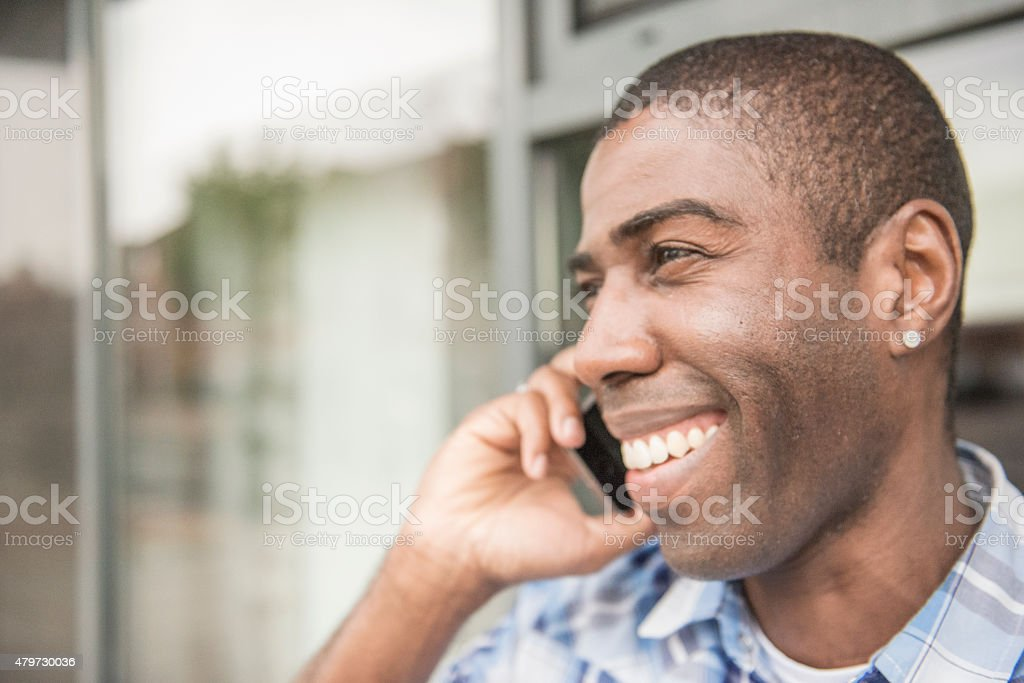 smiling handsome business man on phone royalty-free stock photo
