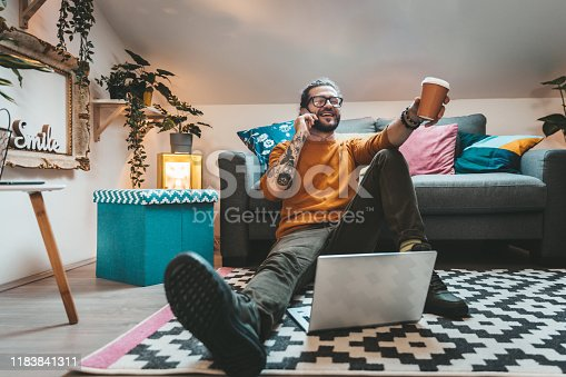 944652612 istock photo Smiling handsome freelancer working with laptop 1183841311