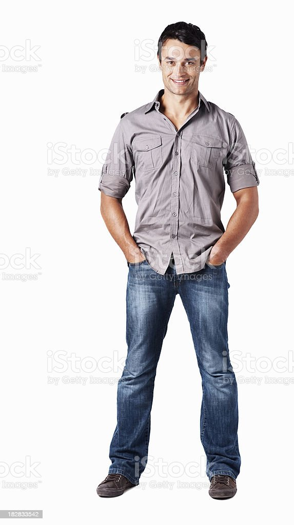 Smiling handsome guy with hands in pockets against white background royalty-free stock photo